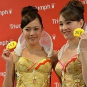 "Models from Triumph International display the new ""Branomics Bra"" on Wednesday in Tokyo."