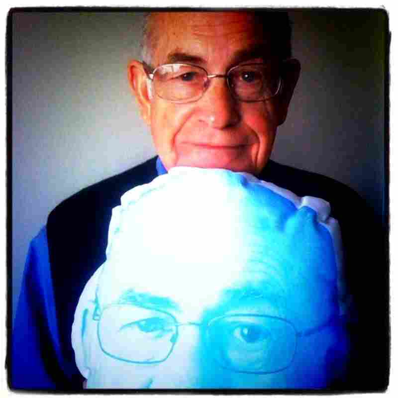 Carl Kasell squeezes a pillow designed after the legendary broadcaster himself. Snag your own at the NPR Shop.