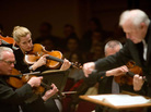 A Detroit Symphony violinist savors a moment in music by Rachmaninov. Leonard Slatkin began the concert with two lesser-known Rachmaninov symphonic poems: The glittering Caprice bohemian and the eerie Isle of the Dead.