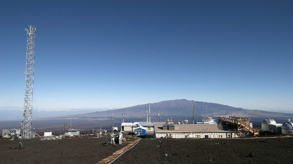 Researchers use the 120-foot tower atop Mauna Loa in Hawaii to collect air samples and measure the amount of carbon dioxide in the atmosphere. Mauna Kea looms in the distance. (forrestmims.org)