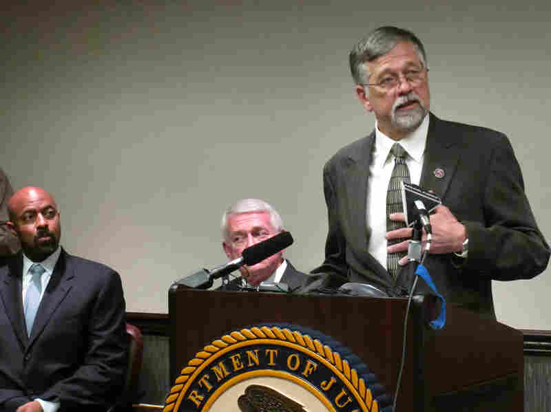 University of Montana President Royce Engstrom, right, discusses the school's effort to reform the way it handles sexual assault cases, as Deputy Assistant Attorney General Roy Austin, left, and U.S. Attorney for Montana Michael Cotter listen.