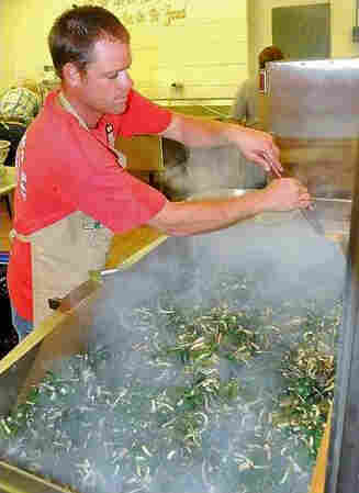 Apprentice cook Ryan McClung sautées ramps for the 2012 ramp festival in Richwood, West Va.