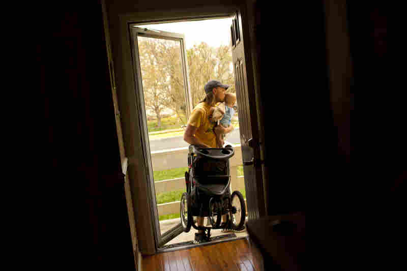 Jonathan juggles Zane and a stroller while rushing to pick up Egan at the neighborhood bus stop. Being the only stay-at-home father in the neighborhood was initially isolating, but he found men in similar situations through a local Yahoo group.
