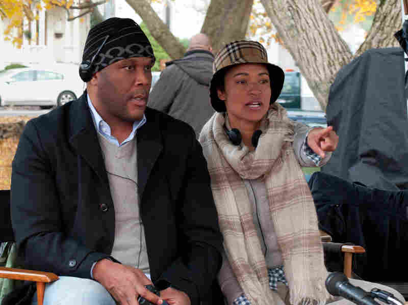 Producer Tyler Perry and writer/director Tina Gordon Chism on the set of Peeples.
