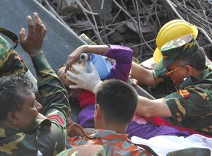 Rescuers carry a survivor who was buried for 17 days under the rubble of a building that collapsed in Saver, near Dhaka, Bangladesh.