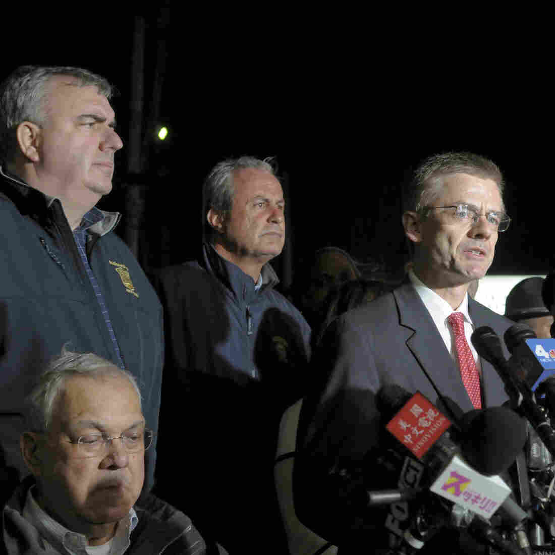FBI Special Agent in Charge Richard DesLauriers (at the microphones), Boston Police Commissioner Edward Davis (standing, at far left) and other authorities briefing the news media on April 19. That's the day Boston bombings suspect Tamerlan Tsarnaev was killed and his brother, Dzhokhar, was captured.