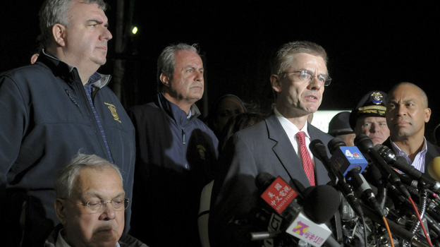 FBI Special Agent in Charge Richard DesLauriers (at the microphones), Boston Police Commissioner Edward Davis (standing, at far left) and other authorities briefing the news media on April 19. That's the day Boston bombings suspect Tamerlan Tsarnaev was killed and his brother, Dzhokhar, was captured. (Reuters /Landov)