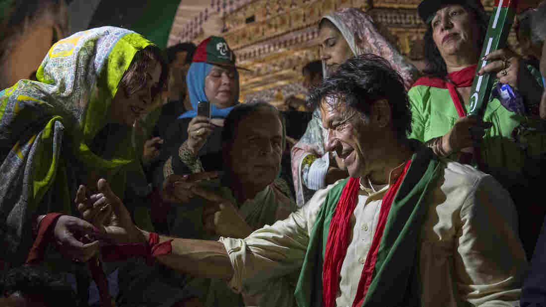 A supporter greets Imran Khan  at a campaign rally on May 6, in Multan, Pakistan. Pakistan's parliamentary elections will be held on Saturda