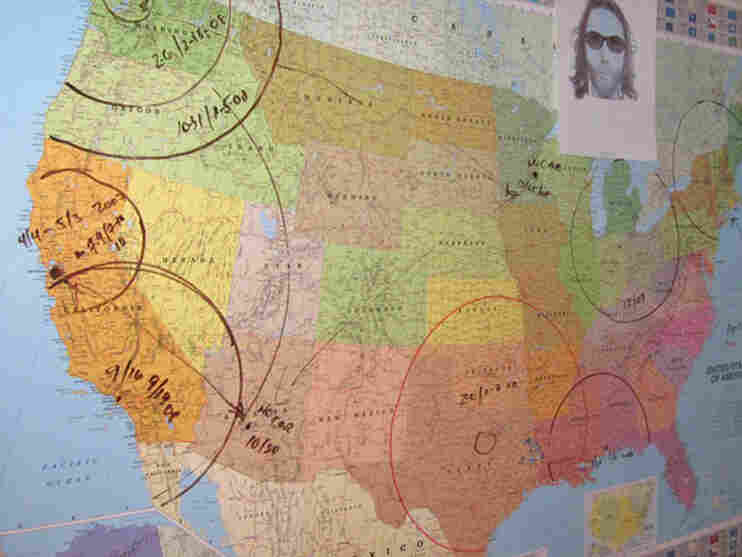 A map at the Anchorage Police Department tracks the travels of confessed killer Israel Keyes. Investigators say the lack of a unified missing persons database is frustrating efforts to identify other potential victims.