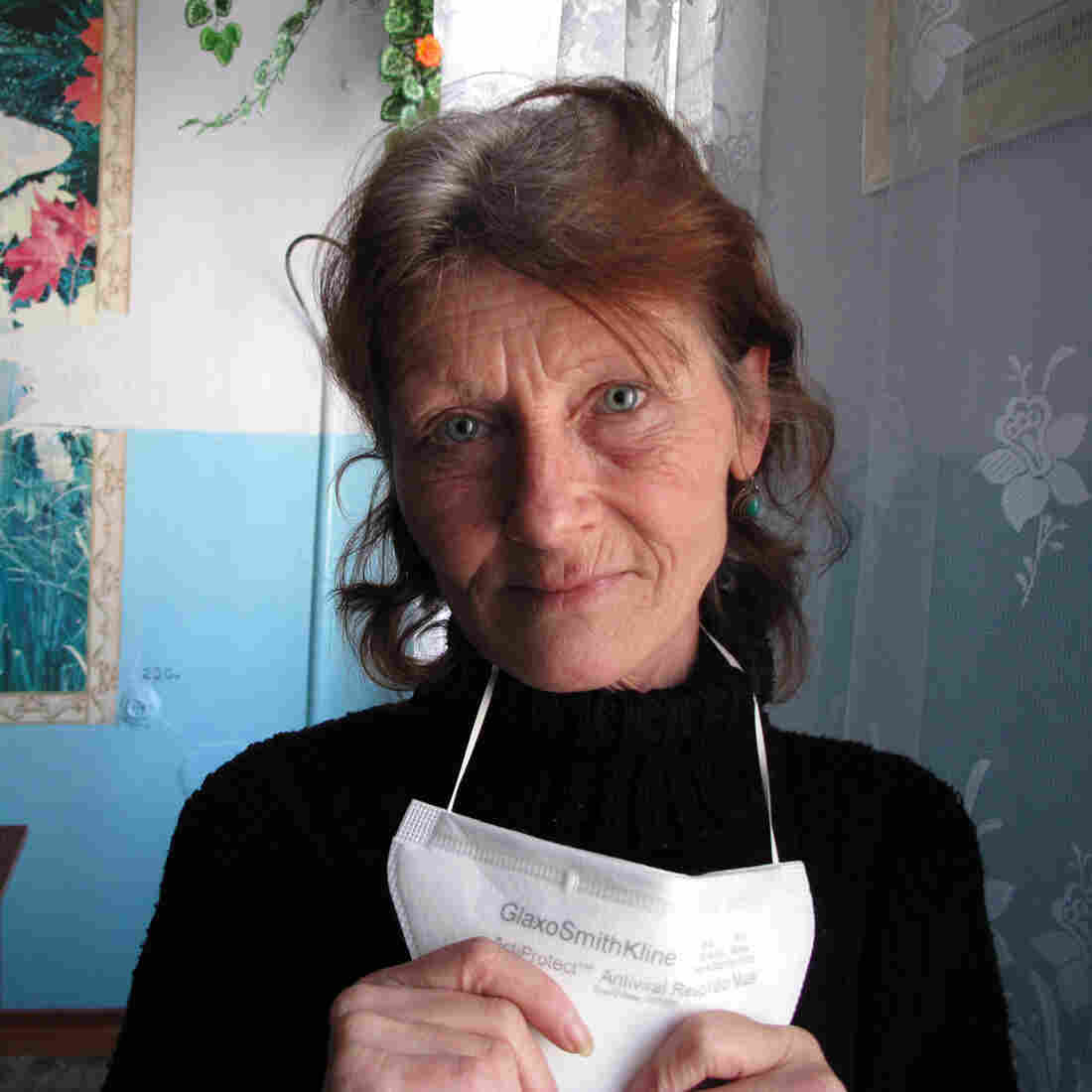 "Maria Smolnitcaia, 52, is a singer living on a TB ward in Balti, Moldova. Smolnitcaia says ""When we take the pills, we feel worse. I'm losing my hearing a little. I feel pain in my bones, in my whole body."""