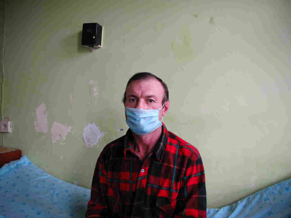 "Nikolay Popa, 47, first caught TB in Ukraine. He's been in the hospital for five months. ""It is very difficult to endure this treatment. It lasts a long time, and it affects my hearing, my eyesight. There are other organs that ache."""