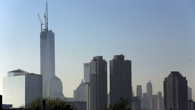 One World Trade Center stands at its full height of 1,776 feet Friday, after a crane lifted its spire into place. The New York City skyline is seen here from the Heights neighborhood of Jersey City, N.J.