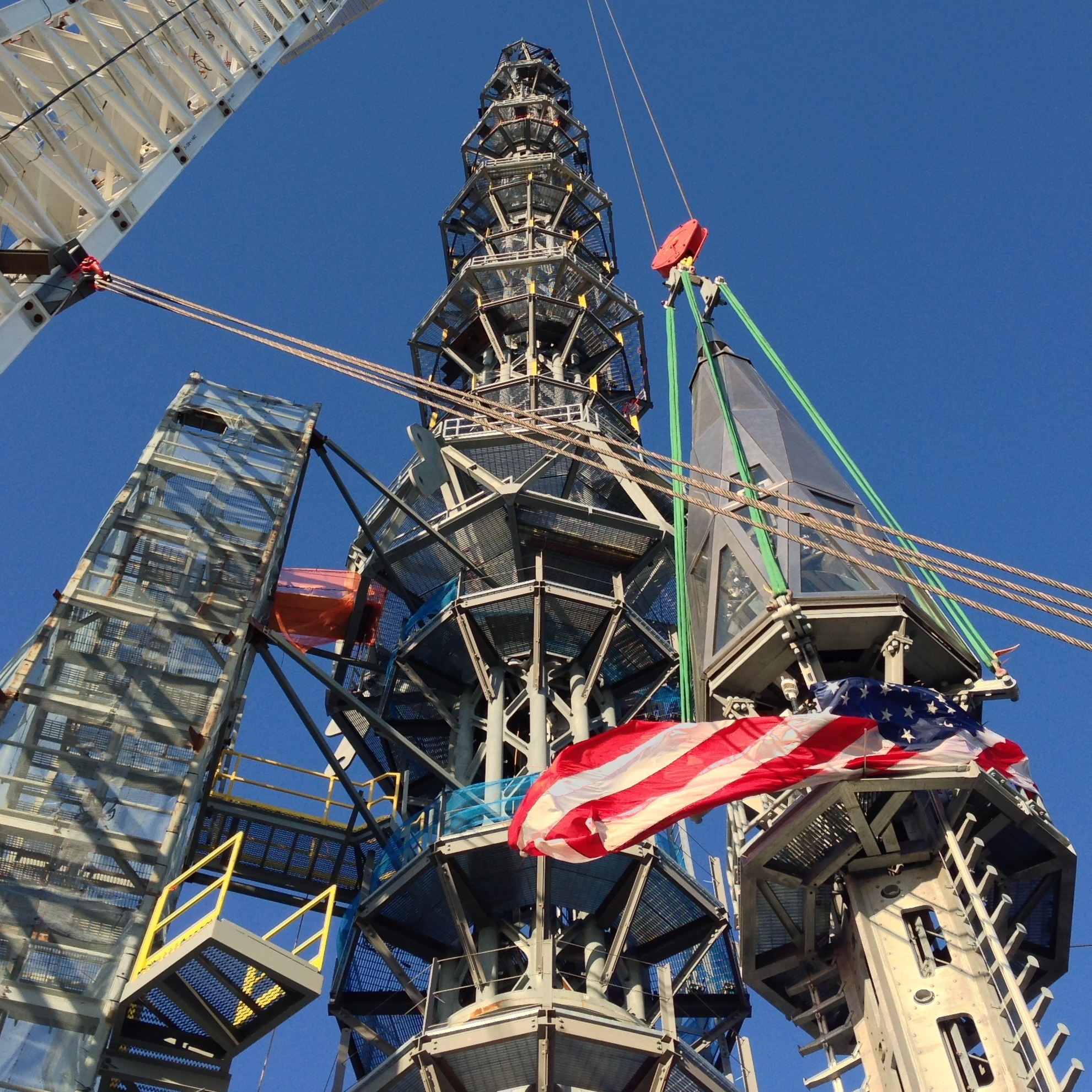 The silver spire is fully installed on One World Trade Center's roof, bringing the structure to its full and symbolic height of 1,776 feet Friday.