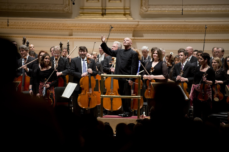 In acknowledging listeners' applause, Eschenbach and the NSO musicians returned the audience's warmth.  (Torsten Kjellstrand for NPR)