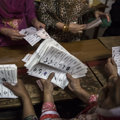 Election workers count ballots at a polling station in Lahore, Pakistan, on Saturday. The election marks the first time in the country's history that an elected government will hand over power to another elected government.