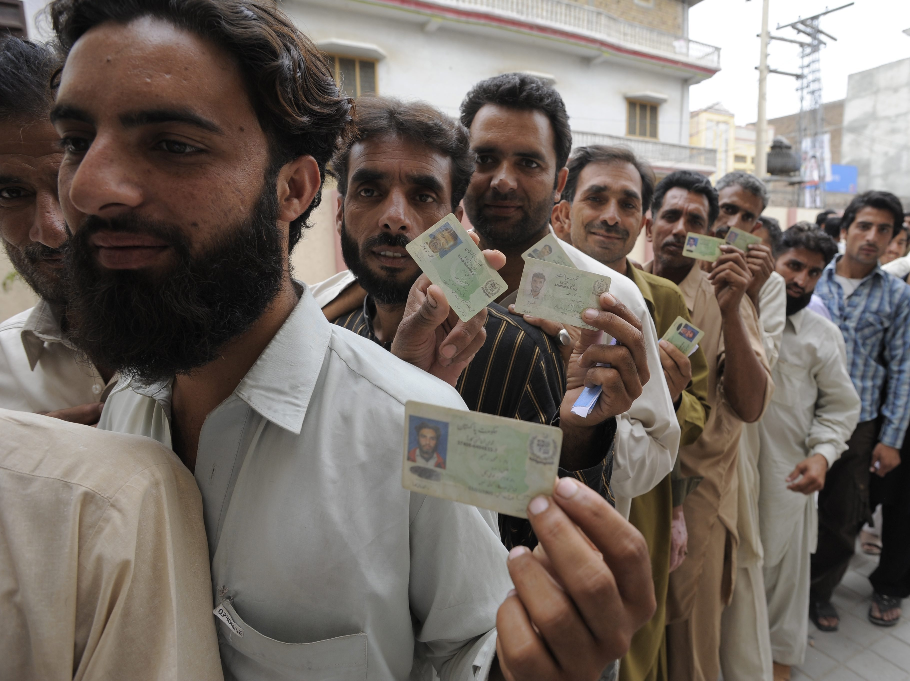 Pakistanis 'Defy Violence' To Vote In Landmark Election