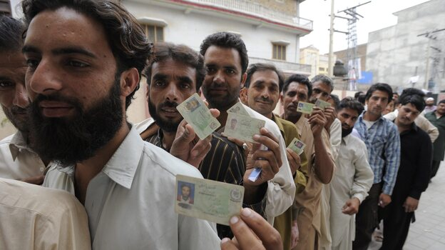 Pakistani men lined up to vote in Rawalpindi on Saturday. Men and women cast ballots separately as millions went to the poll. (EPA /LANDOV)
