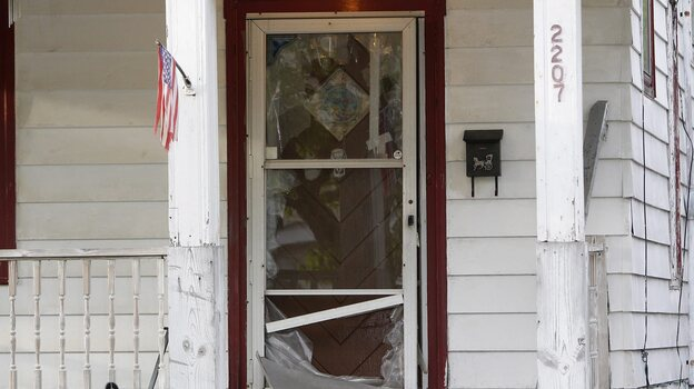 It took neighbors' help for Amanda Berry to escape through the bolted storm door of the Cleveland home where authorities say she and two other women were held captive for nearly a decade. After she emerged, the women and Berry's daughter were rescued. (EPA /LANDOV)