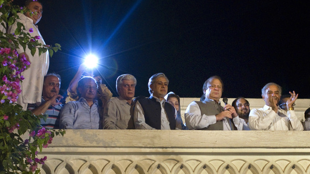 Former Prime Minister Nawaz Sharif, second from right, declares victory in Pakistan's general elections, as his brother Shahbaz Sharif, right, and others listen at the party's headquarters in Lahore. (AP)