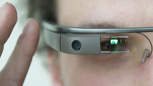 """A visitor at the """"NEXT Berlin"""" conference tries out Google Glass on April 24 in Berlin."""