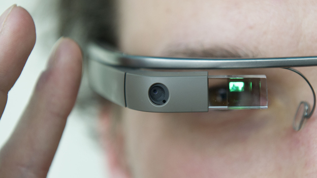 "A visitor at the ""NEXT Berlin"" conference tries out Google Glass on April 24 in Berlin. (AFP/Getty Images)"
