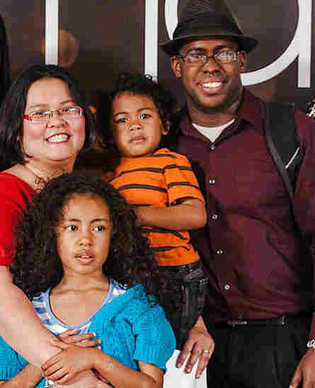 Thien-Kim Lam (left) and Larry Bright (right) with their 3-year-old son and 7-year-old daught