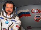 Canadian astronaut Chris Hadfield sits in front of a mock-up of a Soyuz TMA space craft during his pre-flight preparation at the Cosmonaut Training Centre in Star City, outside Moscow, in November 2012.