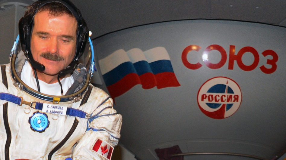 Canadian astronaut Chris Hadfield sits in front of a mock-up of a Soyuz TMA space craft during his pre-flight preparation at the Cosmonaut Training Centre in Star City, outside Moscow, in November 2012. (AFP/Getty Images)