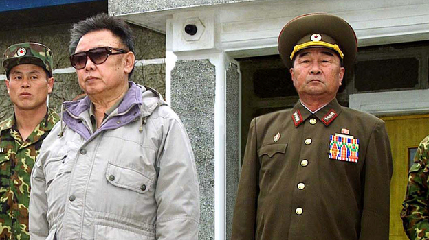 Demoted Defense Chief Kim Kyok Sik (right) with the late North Korean leader Kim Jong Il in a 2007 file photo released by Korean Central News Agency. (AP)