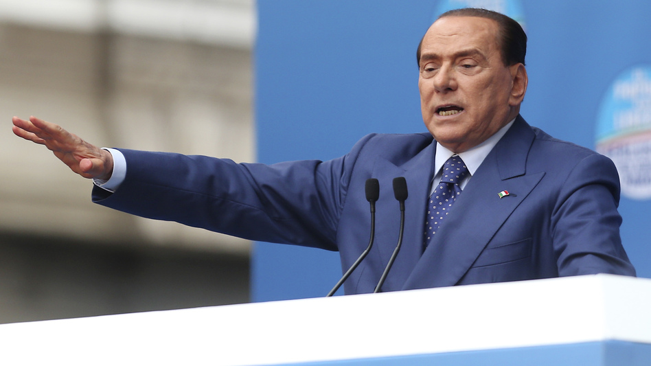 Silvio Berlusconi spoke Saturday at a rally in Brescia, Italy. The former prime minister could face a jail term of six years and a lifetime ban from holding political office in a sex-for-hire case. (AP)