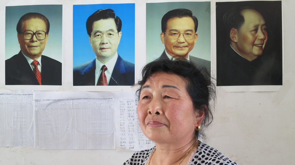 The wife of Li Yiqian, Yang Liming, sits in their house, which is plastered with pictures of China's leaders, an attempt to help prevent local authorities from demolishing it. Her husband has been sentenced to three years in prison for organizing a crowd to create a disturbance; she believes it's for his work in helping dispossessed villagers petition. (NPR)