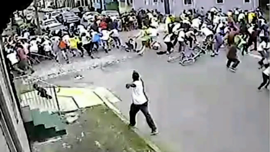 An image taken from a video released by New Orleans Police Monday shows a suspect in the Mother's Day parade shootings that left 19 people wounded. (NOPD)