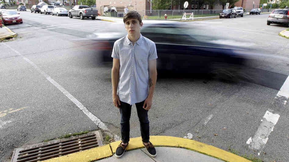 Dylan Young, then 18, posed for a photo as a vehicle cruised by North Arlington, N.J., in June 2012. Young was in a fender-bender accident caused by being distracted while texting and driving.