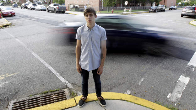 Dylan Young, then 18, posed for a photo as a vehicle cruised by North Arlington, N.J., in June 2012. Young was in a fender-bender accident caused by being distracted while texting and driving. (AP)