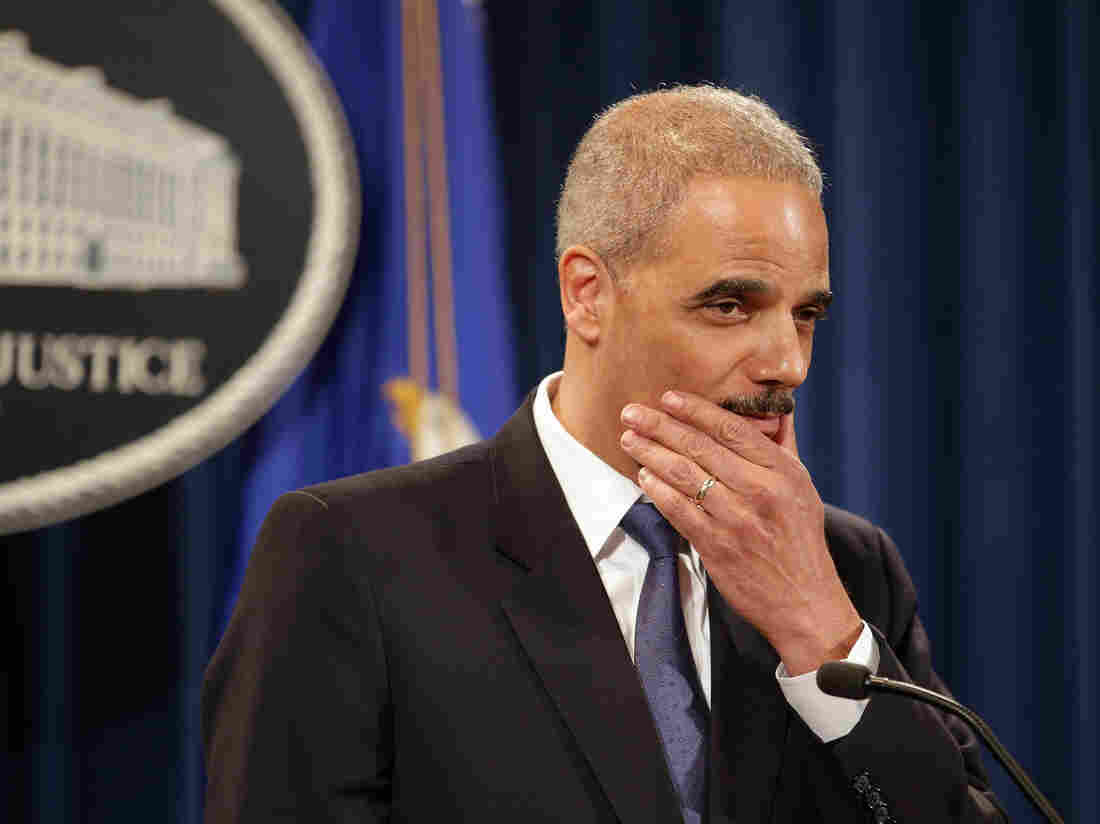 Attorney General Eric Holder says he recused himself last year from a national security leak probe in which prosecutors obtained the phone records of Associated Press journalists.