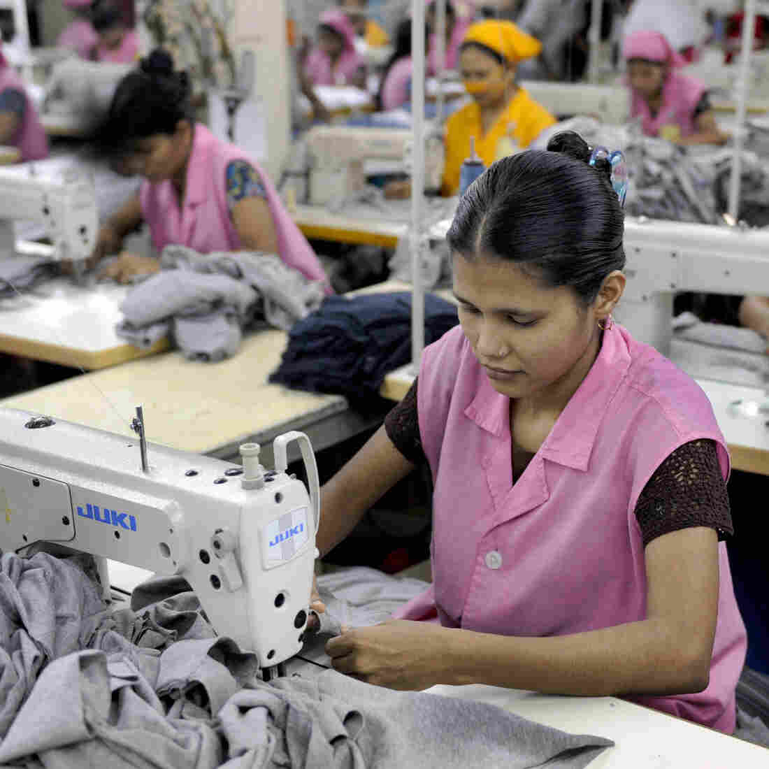 Garment workers sew T-shirts at a factory in Dhaka, Bangladesh, in 2009.