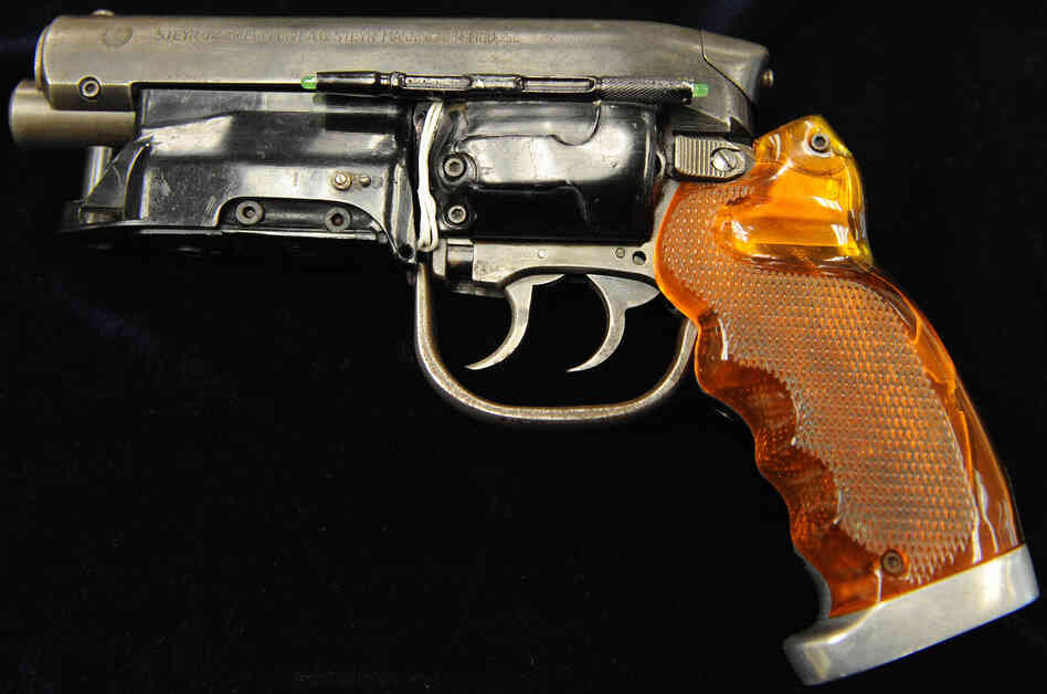 There's always a girl and there's always a gun: the Hero-Blaster used by Harrison Ford's character in the movie Blade Runner. The gun was up for auction in 2009.
