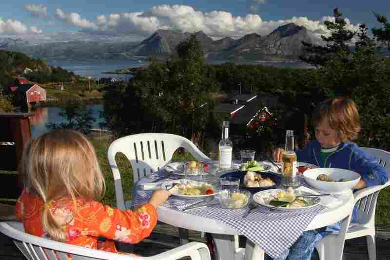 Marcus, 6, and Nora, 4, eat dinner on their first night at home on Rødøy.