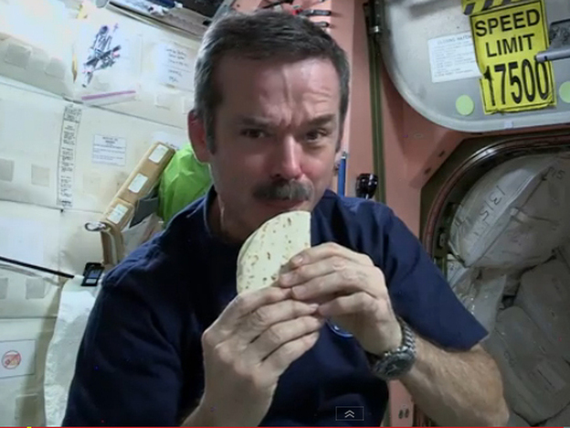 Cmdr. Chris Hadfield demonstrates how to make a sandwich, space station-style. (Screenshot from YouTube)