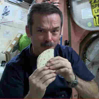 Cmdr. Chris Hadfield demonstrates how to make a sandwich, space station-style.