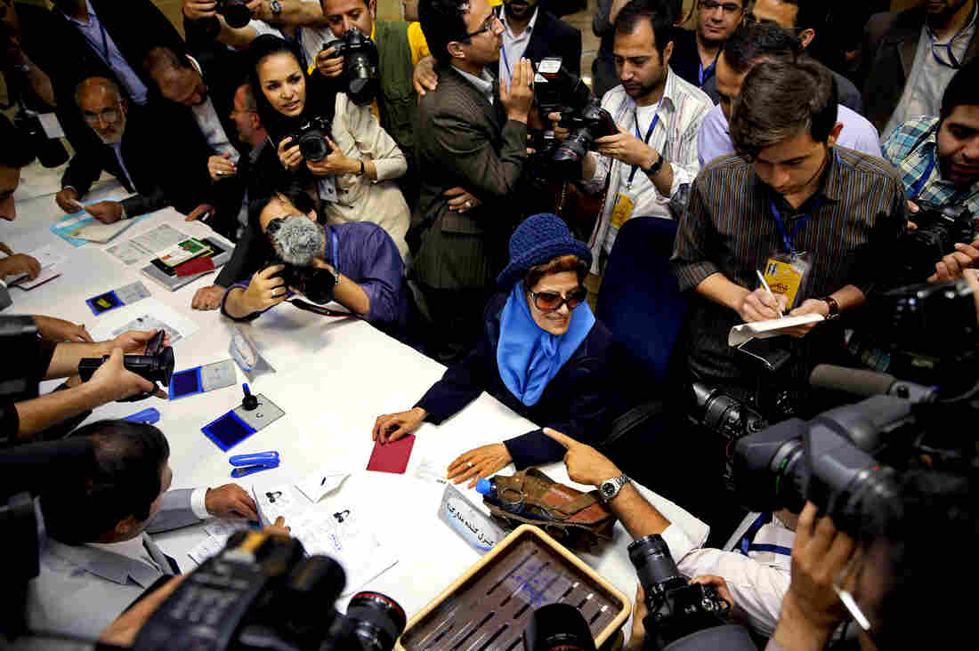 Etrat Kazemi (center) registers her candidacy for the upcoming presidential election in Tehran, Iran, last week. More than 700 people have registered to run in the June 14 election.