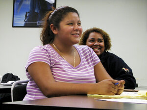Jackeline Lizama (front) plans to attend a local community college after she graduates next month from her high school