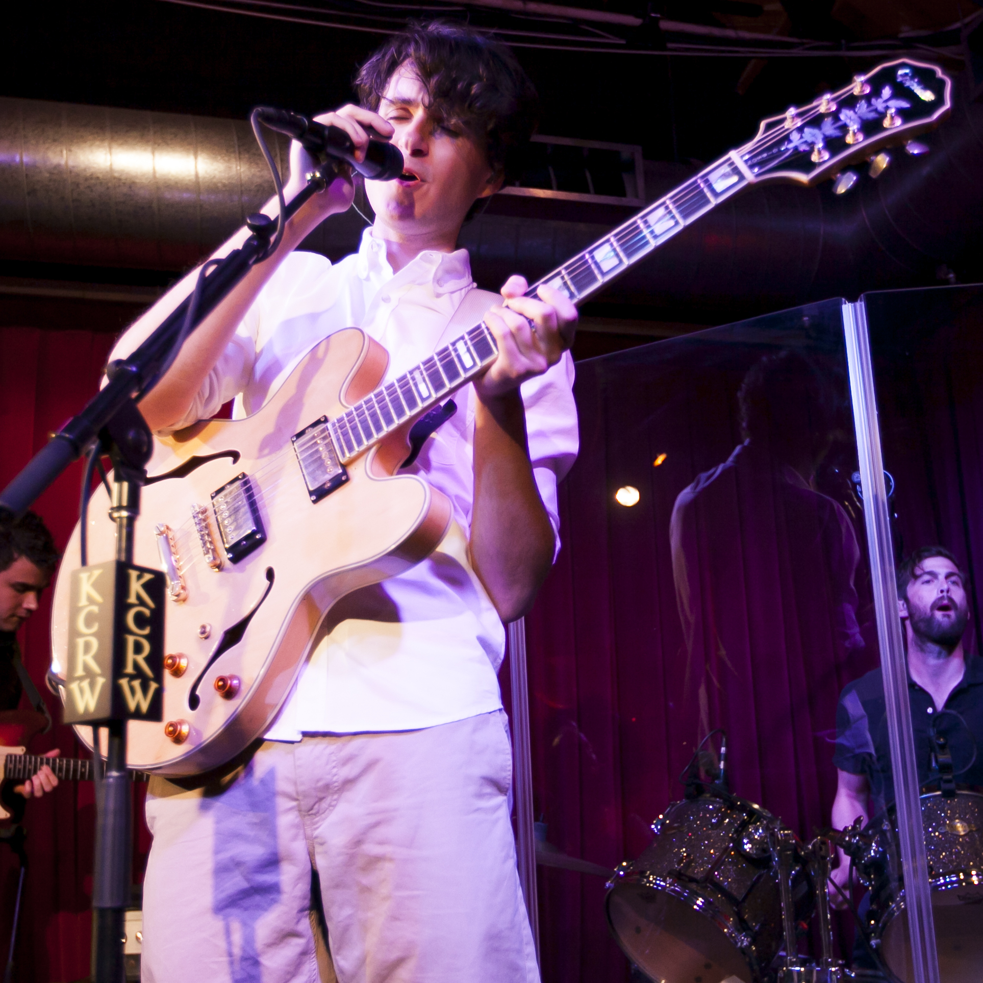 Rostam Batmanglij, Ezra Koenig and Chris Tomson of Vampire Weekend perform a special show at Apogee's Berkeley Street Studio in Santa Monica, Calif.