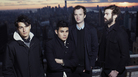 Vampire Weekend's third album is titled Modern Vampires of the City. Singer Ezra Koenig (far left) says he sees it as the closing chapter of a trilogy.
