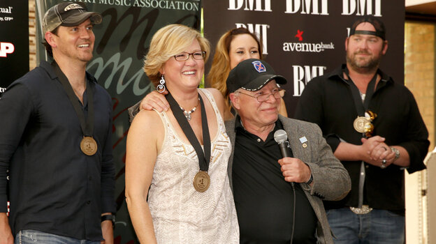 "On Monday, the team behind Lee Brice's ""I Drive Your Truck"" gathered in Nashville to celebrate the song's reaching No. 1 on the Billboard Country Airplay chart. From left: co-songwriters Jimmy Yeary, Connie Harrington and Jessi Alexander, military father Paul Monti and singer Lee Brice."
