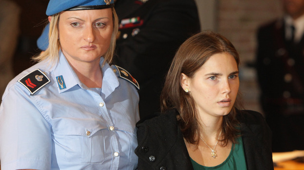 Amanda Knox enters an Italian court on Oct. 3, 2011, just before being acquitted of murdering her British roommate, Meredith Kercher. (AP)