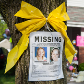 A missing poster is left on a tree outside Amanda Berry's home in Cleveland last week.