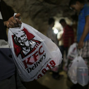 KFC is delivered in one of the many underground smuggling tunnels connecting Egypt to the Gaza Strip city of Rafah.