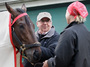 Kentucky Derby winner Orb gets a blanket put on him by exercise rider Jennifer Patterson and trainer Shug McGaughey after a workout earlier this week at Pimlico Race Course in Baltimore. Orb contends Saturday for the Preakness Stakes, the second leg of thoroughbred racing's Triple Crown.