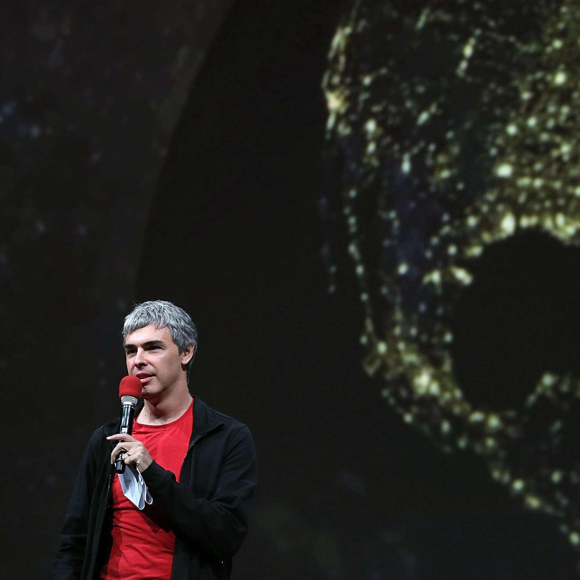 Larry Page, Google co-founder and CEO, speaks Wednesday at the Google I/O developers conference in San Francisco. The new version of Google Maps incorporates images from Google Earth.